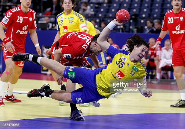 Andreas Nilsson of Sweden scores during the Men's European Handball Championship 2012 main group 1 match between Poland and Sweden at Belgrade Arena...