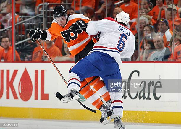 Andreas Nodl of the Philadelphia Flyers collides with Jaroslav Spacek of the Montreal Canadiens in open ice in Game One of the Eastern Conference...