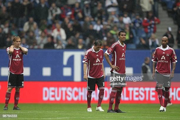 Andreas Ottl Albert Bunjaku Eric Maxim ChoupoMoting and Mickael Tavares of Nuernberg are seen during during the Bundesliga match between Hamburger SV...