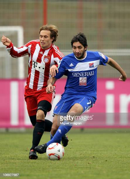 Andreas Ottl of Bayern Muenchen and Leandro Grech of Unterhaching fight for the ball during the friendly match between FC Bayern Muenchen and SpVgg...