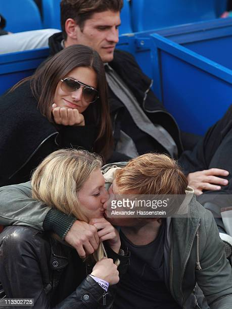 Andreas Ottl of FC Bayern Muenchen attends with his girlfriend Veronika and his team mate Mario Gomez with girlfriend Silvia Meichel the final match...