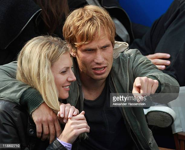Andreas Ottl of FC Bayern Muenchen attends with his girlfriend Veronika the final match between Florian Mayer of Germany and Nikolay Davydenko of...