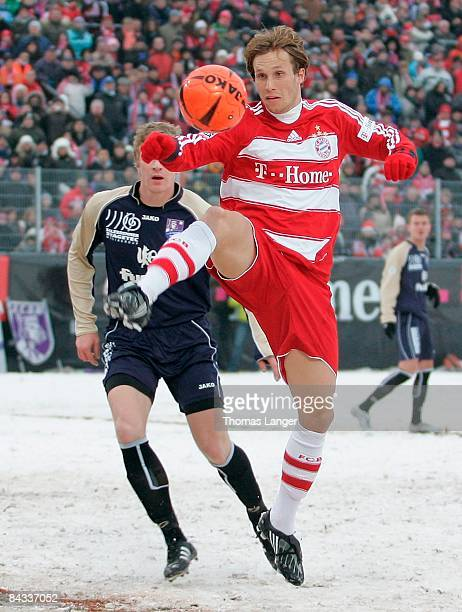Andreas Ottl of Munich and Marco Hillemeyer of Bamberg battle for the ball during the friendly match between FC Eintracht Bamberg and FC Bayern...