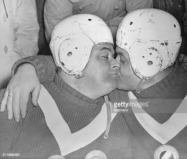 Andreas Oustler, a 32 year old innkeeper of Grainau, Germany and the No. 2 man of the German Bobsled Team, Lorenz Nieberl extend a hearty mutual...
