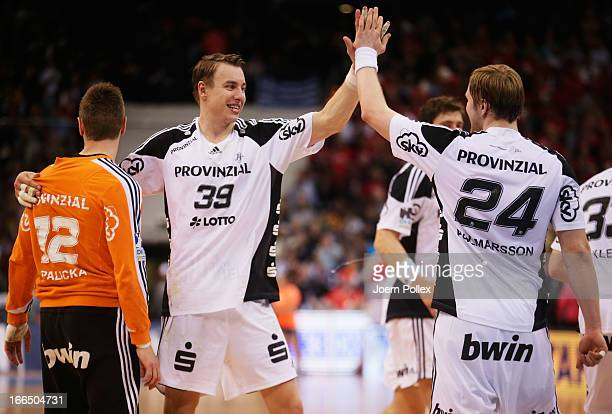 Andreas Palicka Filip Jicha and Aron Palmarsson of Kiel celebrate after winning the Lufthansa Final Four SemiFinal between MT Melsungen and THW Kiel...