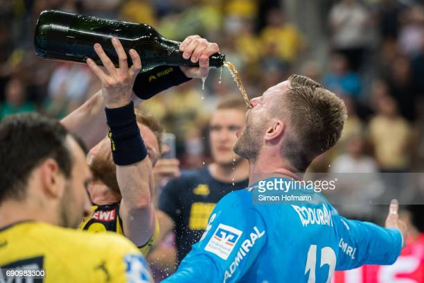 Andreas Palicka of RheinNeckar Loewen is showered in champagne after the DKB HBL match between RheinNeckar Loewen and THW Kiel at SAP Arena on May 31...