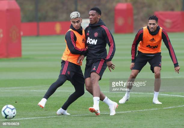 Andreas Pereira and Anthony Martial of Manchester United in action during a first team training session at Aon Training Complex on July 13 2018 in...