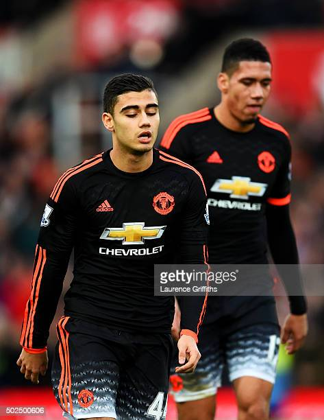 Andreas Pereira and Chris Smalling of Manchester United react as they leave the pitch after the Barclays Premier League match between Stoke City and...