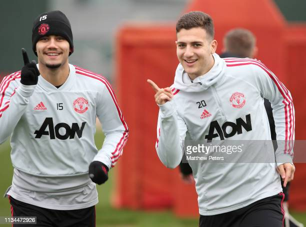 Andreas Pereira and Diogo Dalot of Manchester United in action during a training session at Aon Training Complex on March 08 2019 in Manchester...