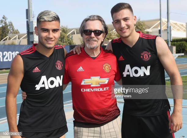 Andreas Pereira and Diogo Dalot of Manchester United pose with actor Gary Oldman after a first team training session as part of their preseason tour...