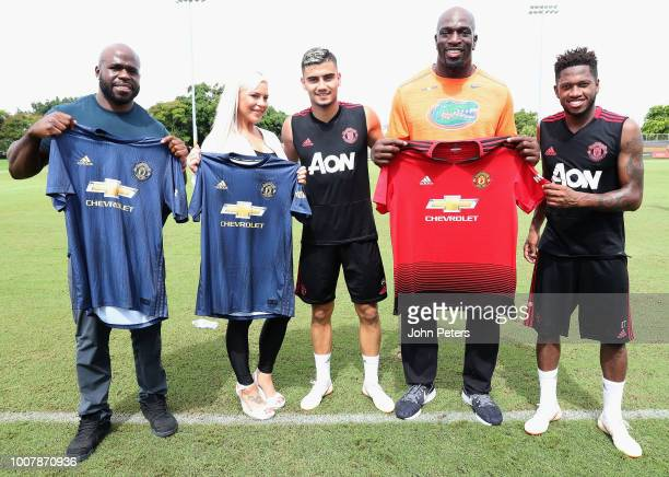 Andreas Pereira and Fred of Manchester United pose with WWE wrestlers Apollo Crews, Dana Brooke and Titus O'Neil after a training session as part of...