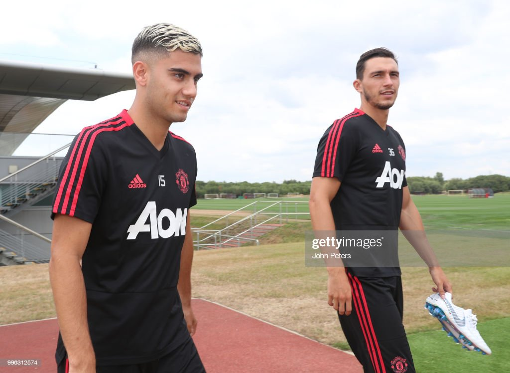 Andreas Pereira and Matteo Darmian of Manchester United walk out ahead of a first team training session at Aon Training Complex on July 11, 2018 in Manchester, England.