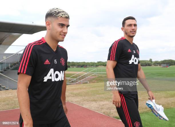 Andreas Pereira and Matteo Darmian of Manchester United walk out ahead of a first team training session at Aon Training Complex on July 11 2018 in...