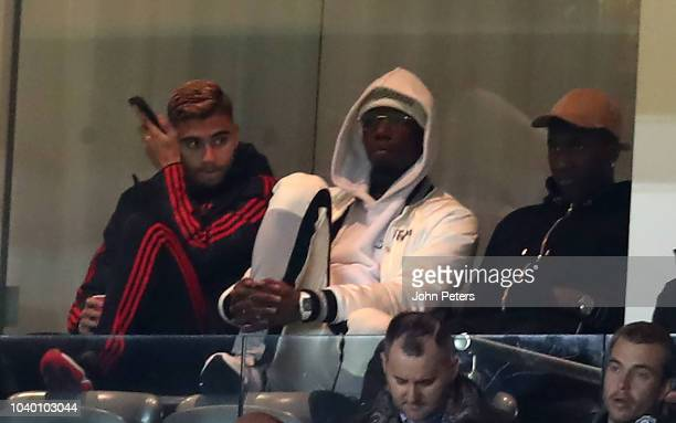 Andreas Pereira and Paul Pogba Manchester United watch from the stand during the Carabao Cup Third Round match between Manchester United and Derby...
