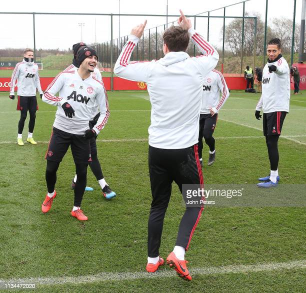Andreas Pereira and Victor Lindelof of Manchester United in action during a training session at Aon Training Complex on March 08 2019 in Manchester...