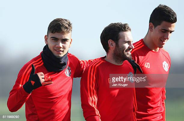 Andreas Pereira Juan Mata and Joel Castro Pereira look on during a Manchester United training session ahead of their UEFA Europa League round of 32...