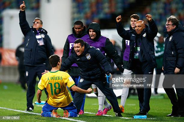 Andreas Pereira of Brazil celebrates with his teams bench after scoring a penalty in the final minutes of the game during the FIFA U20 World Cup New...