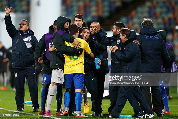 Andreas Pereira of Brazil celebrates with his teams bench after scoring a penalty in the final minutes of the game during the FIFA U-20 World Cup New...