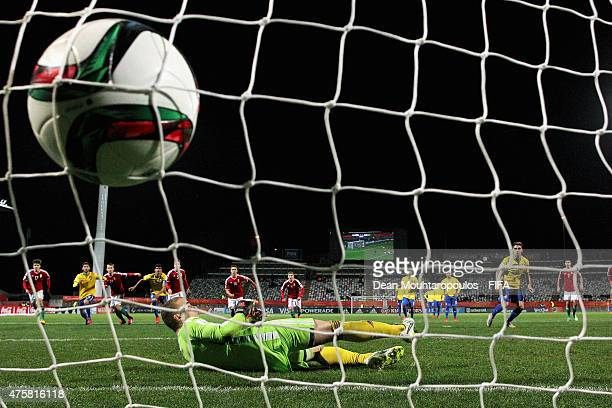 Andreas Pereira of Brazil takes and scores a penalty in the final minutes of the game past goalkeeper Gyorgy Szekely of Hungary during the FIFA U20...