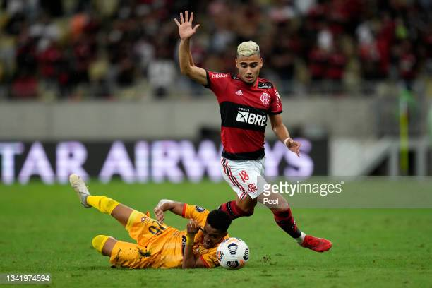 Andreas Pereira of Flamengo fights for the ball with Byron Castillo of Barcelona SC during a semi final first leg match between Flamengo and...