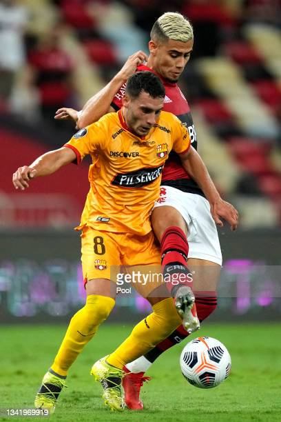 Andreas Pereira of Flamengo fights for the ball with Leandro Martinez of Barcelona SC during a semi final first leg match between Flamengo and...
