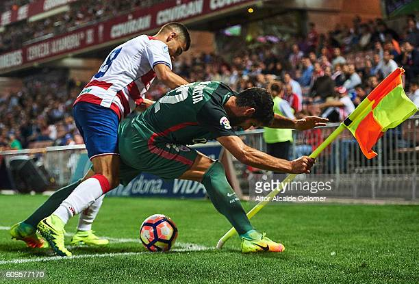Andreas Pereira of Granada CF competes for the ball with Raul Garcia of Athletic Club during the match between Granada CF vs SD Eibar as part of La...