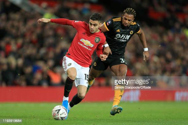 Andreas Pereira of Man Utd battles with Adama Traore of Wolves during the FA Cup Third Round Replay match between Manchester United and Wolverhampton...