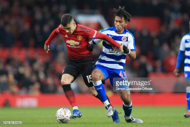 Andreas Pereira of Man Utd battles with Danny Loader of Reading during the FA Cup Third Round match between Manchester United and Reading at Old...