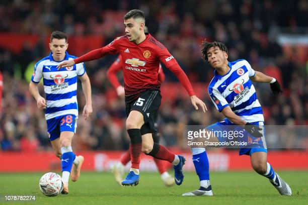 Andreas Pereira of Man Utd gets away from Danny Loader of Reading during the FA Cup Third Round match between Manchester United and Reading at Old...