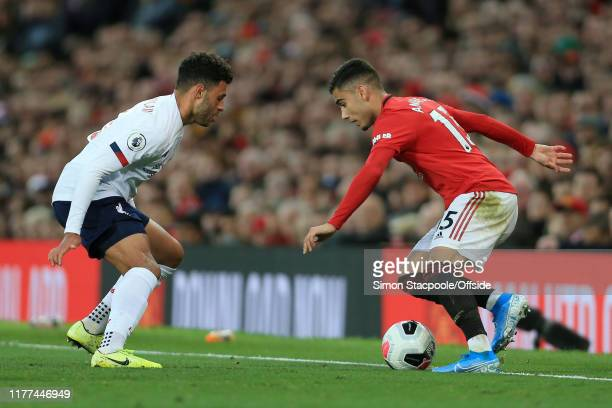 Andreas Pereira of Man Utd takes on Alex OxladeChamberlain of Liverpool during the Premier League match between Manchester United and Liverpool FC at...