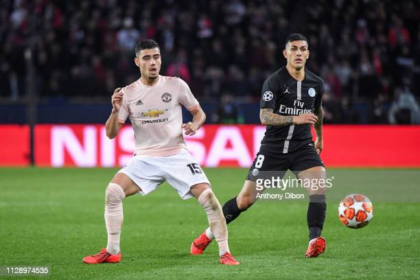 Andreas Pereira of Manchester and Leandro Paredes of PSG during the UEFA Champions League Round of 16 Second Leg match between Paris Saint Germain...