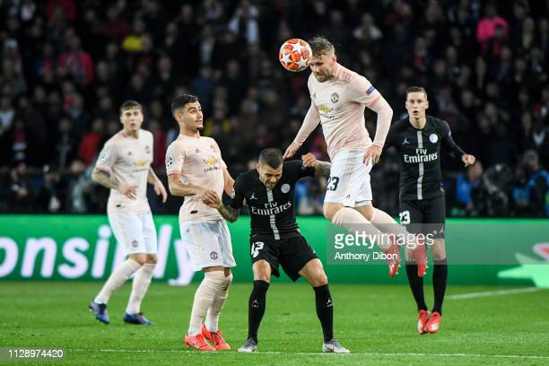 Andreas Pereira of Manchester Daniel Alves of PSG and Luke Shaw of Manchester during the UEFA Champions League Round of 16 Second Leg match between...
