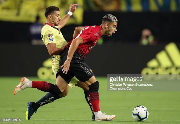 Andreas Pereira of Manchester United and Henry Martin of Club America in action during the International Champions Cup game at the University of...