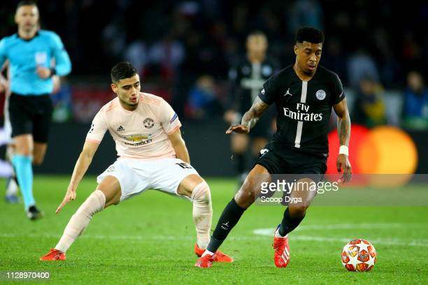 Andreas Pereira of Manchester United and Presnel Kimpembe of Paris Saint Germain during the UEFA Champions League Round of 16 Second Leg match...