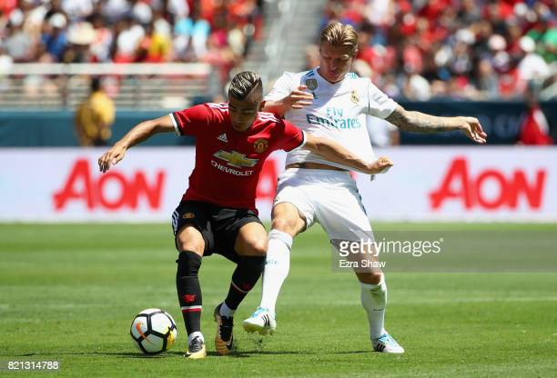 Andreas Pereira of Manchester United and Toni Kroos of Real Madrid go for the ball during the International Champions Cup match at Levi's Stadium on...