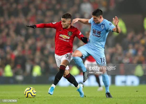 Andreas Pereira of Manchester United battles for possession with Ashley Westwood of Burnley during the Premier League match between Manchester United...
