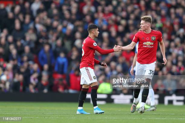 Andreas Pereira of Manchester United celebrates after scoring a goal to make it 10 with Scott McTominay during the Premier League match between...