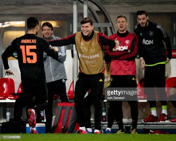Andreas Pereira of Manchester United celebrates scoring their fifth goal goal during the UEFA Europa League round of 16 first leg match between LASK...
