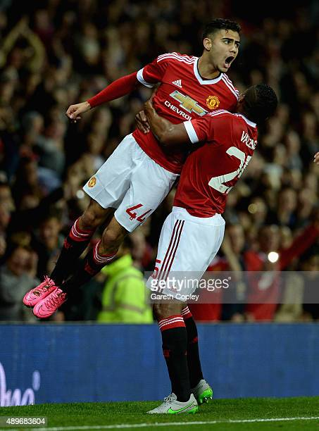 Andreas Pereira of Manchester United celebrates with Antonio Valencia after scoring his team's second goal during the Capital One Cup Third Round...