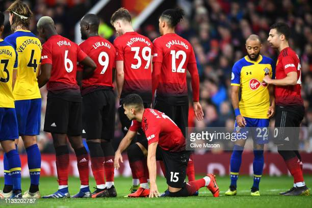 Andreas Pereira of Manchester United hides behind the wall during the Premier League match between Manchester United and Southampton FC at Old...