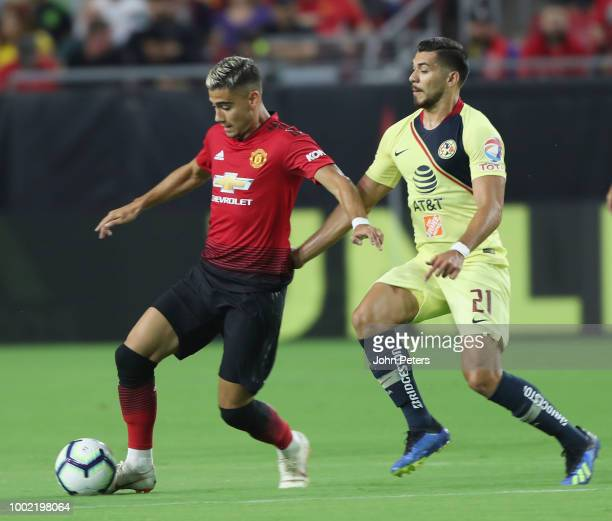 Andreas Pereira of Manchester United in action with Henry Martin of Club America during the preseason friendly match between Manchester United and...