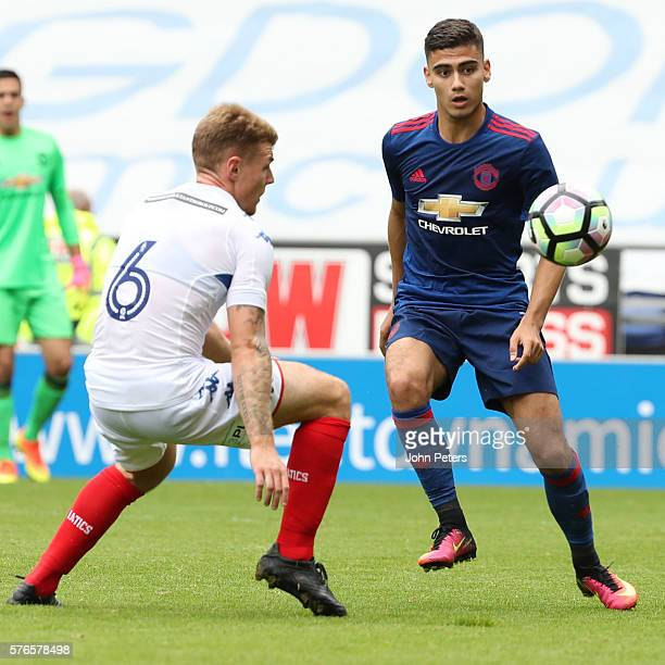 Andreas Pereira of Manchester United in action with Max Power of Wigan Athletic during the preseason friendly match between Wigan Athletic and...