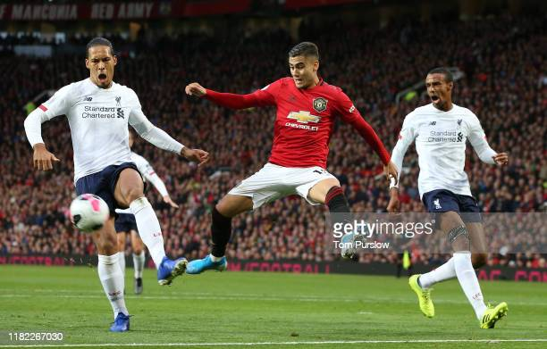 Andreas Pereira of Manchester United in action with Virgil van Dijk and Joel Matip of Liverpool during the Premier League match between Manchester...