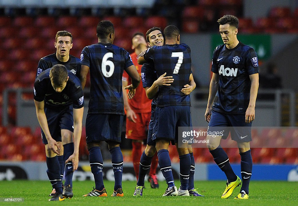 Andreas Pereira of Manchester United is congratulated by team-mate Saidy Janko after scoring the opening goal during the Barclays U21 Premier League Semi Final match between Liverpool and Manchester United at Anfield on May 02, 2014 in Liverpool, England.