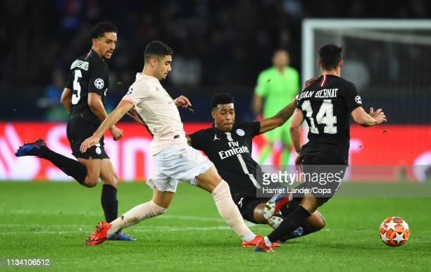 Andreas Pereira of Manchester United is tackled by Presnel Kimpembe of Paris SaintGermain during the UEFA Champions League Round of 16 Second Leg...
