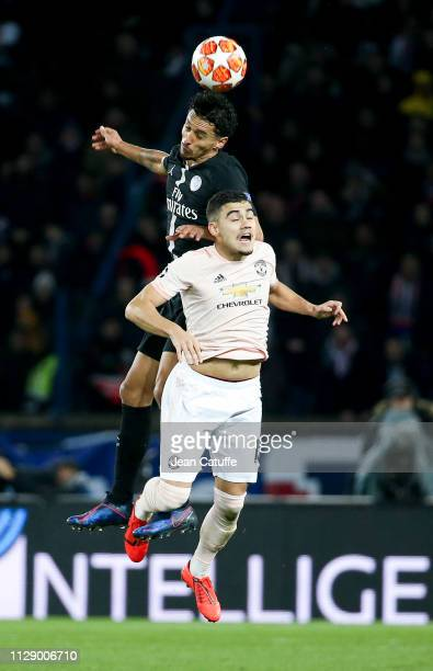 Andreas Pereira of Manchester United Marquinhos of PSG during the UEFA Champions League Round of 16 Second Leg match between Paris SaintGermain and...