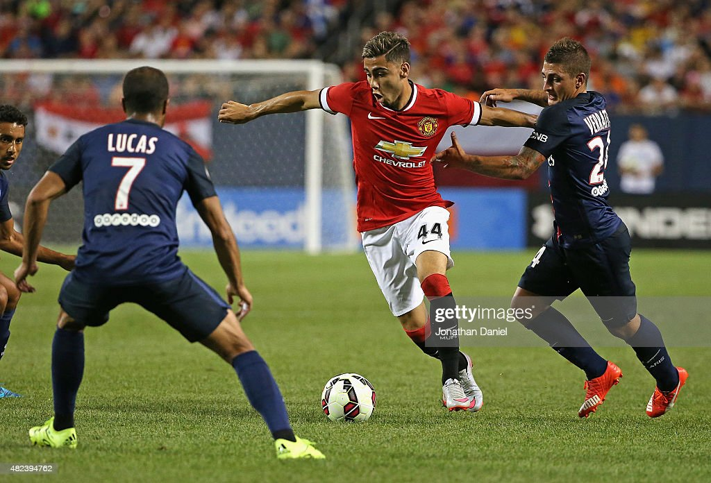 Andreas Pereira #44 of Manchester United moves between Lucas Moura #7 and Marco Verratti #24 of Paris Saint-Germain during a match in the 2015 International Champions Cup at Soldier Field on July 29, 2015 in Chicago, Illinois. Paris Saint-Germain defeated Manchester United 2-0.