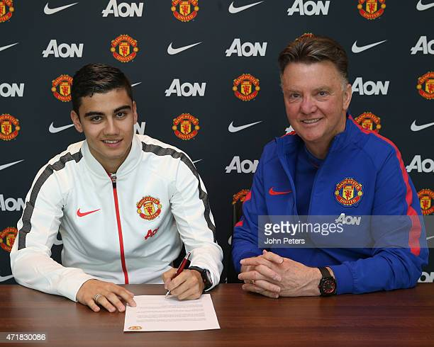 Andreas Pereira of Manchester United poses with manager Louis van Gaal after signing a contract extension at Aon Training Complex on May 1 2015 in...