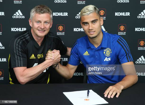 Andreas Pereira of Manchester United poses with Manager Ole Gunnar Solskjaer after signing a new contract with the club at Aon Training Complex on...