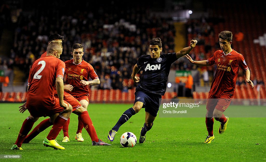 Andreas Pereira of Manchester United runs at the Liverpool defence during the Barclays U21 Premier League Semi Final match between Liverpool and Manchester United at Anfield on May 02, 2014 in Liverpool, England.